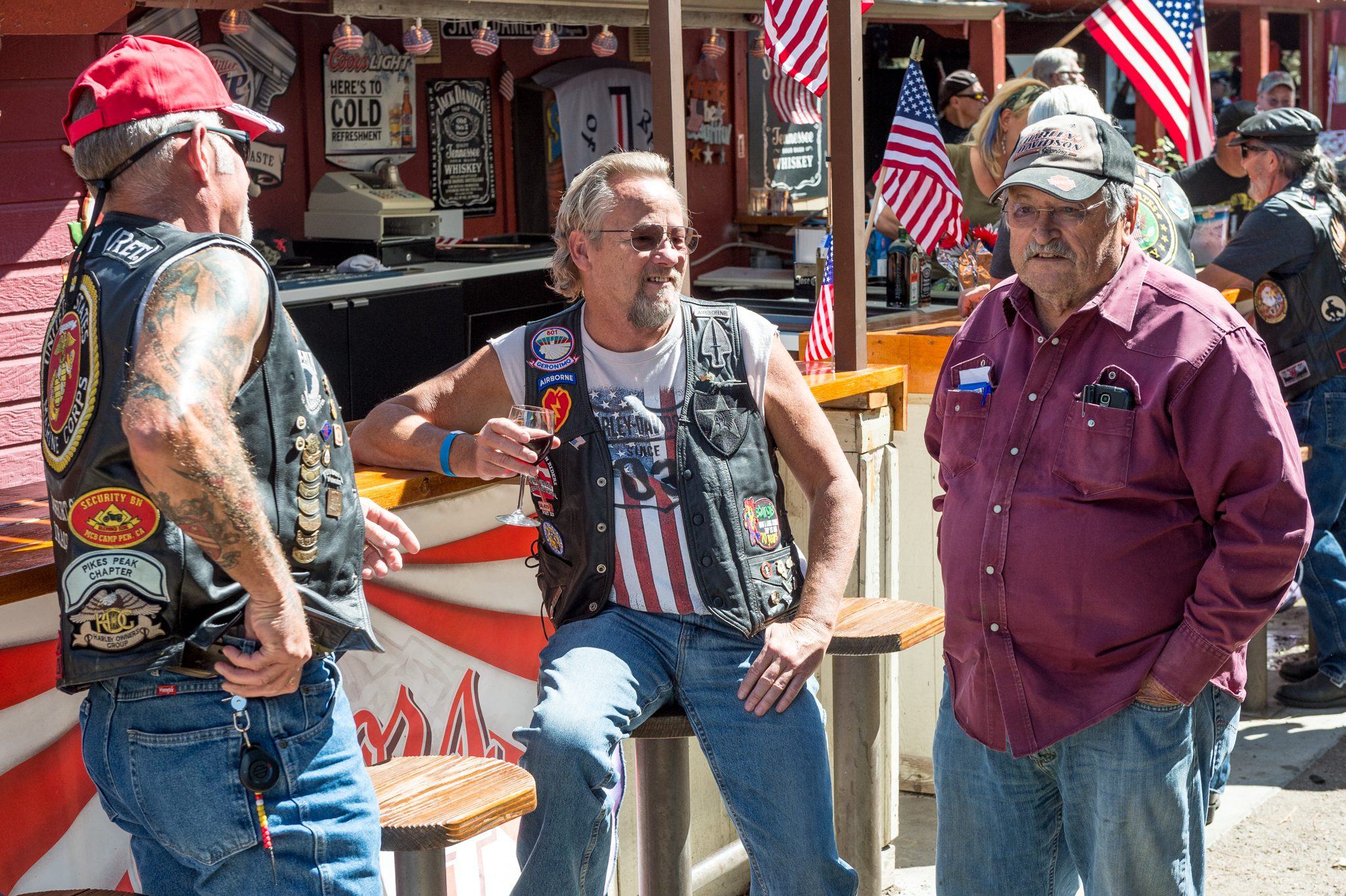 Three men enjoying refreshments after Colorado Wounded Vet Ride