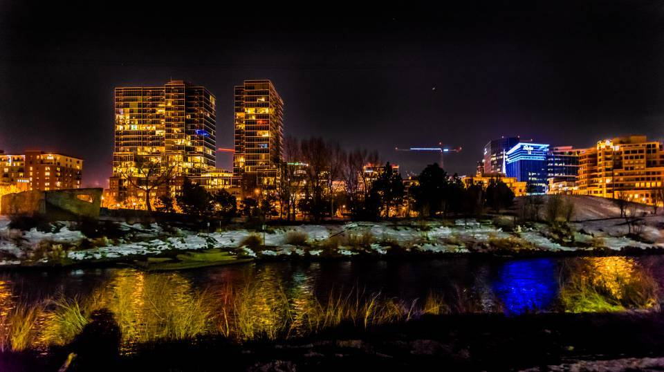 Downtown Denver with reflection in South Platte at night