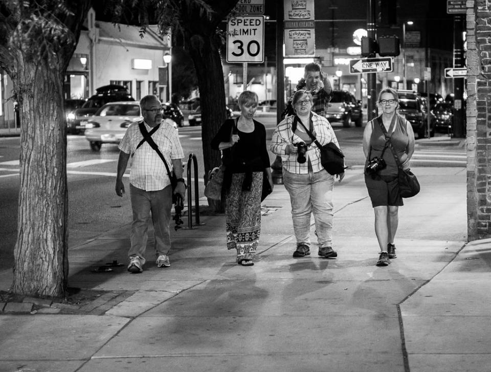 Group of photographers at night on street