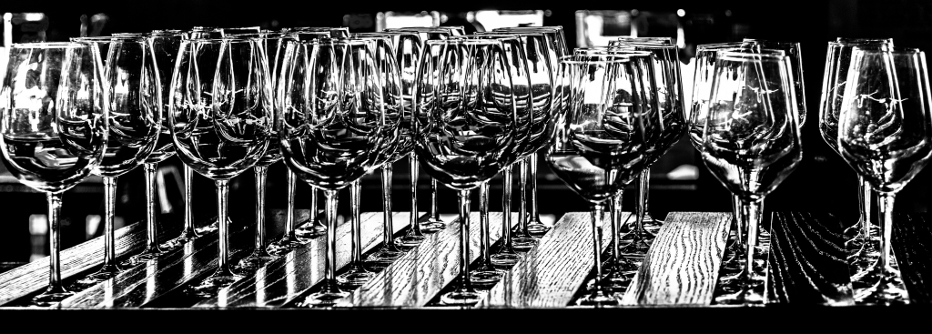 Rows of wine glasses in black and white