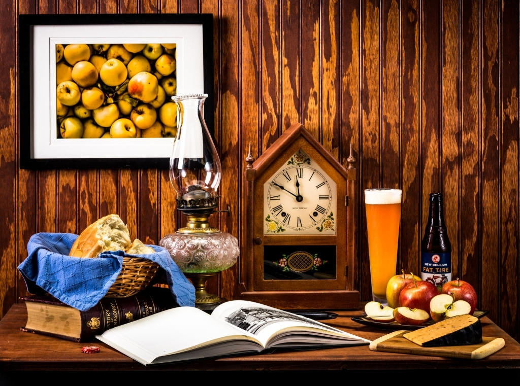 Still life of book, food, and beer