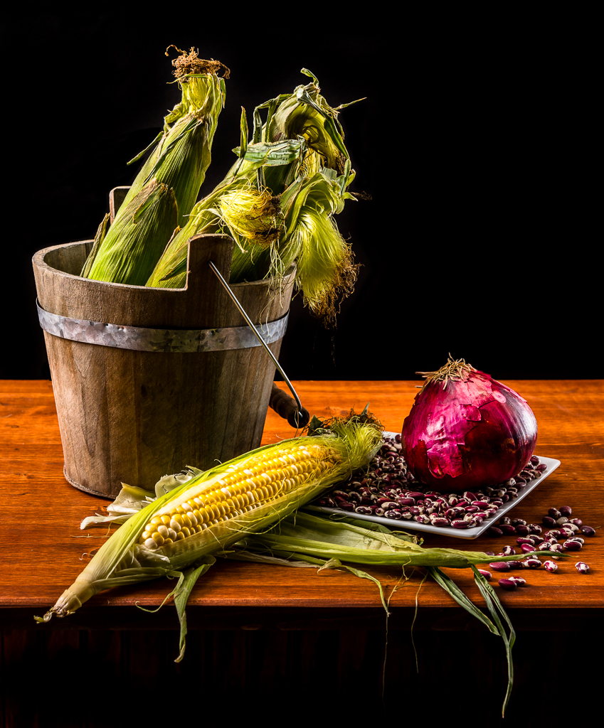 Still life of corn, beans, and onions